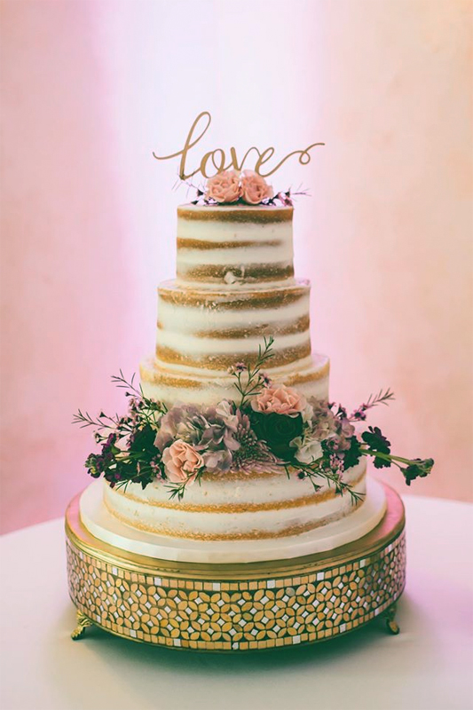 A naked cake with fresh flowers.